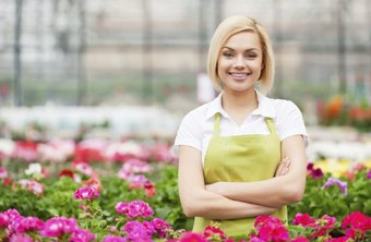 Outdoor sales representative standing in plant section of store