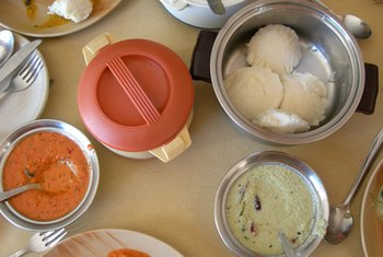 Idli are small, disk-shaped cakes.