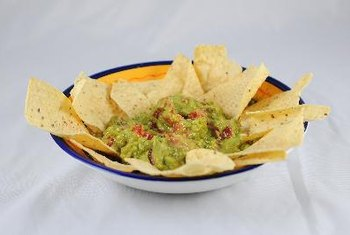 Guacamole may be healthy, but the chips usually served with it are not.