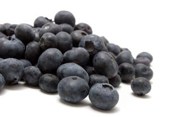 Blueberries provide deep, vibrant color in a smoothie that also includes bananas and flaxseed oil.