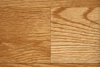 Laminate often is indistinguishable from hardwood flooring, even up close.