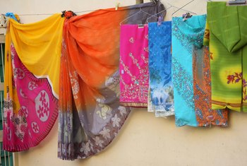 Used saris make colorful wall hangings and furniture covers