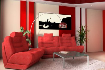 Art and red decals add color to the walls in this white room.