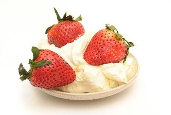 Berries and sugar-free whipped cream make a delicious low-carb dessert for diabetics.