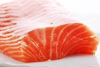 Check salmon's internal temperature to prevent undercooking.