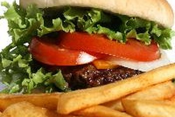 Children may love cheeseburgers and fries, but they are high in calories and saturated fat.
