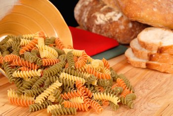 Pasta and bread both contain carbohydrates and generally are not part of a low-carb diet.