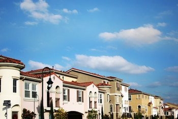 Consider privacy and expense when shopping for town homes in planned communities.