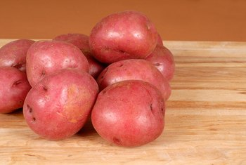 Red potatoes with skins are rich in carbohydrates, fiber, vitamins and minerals.