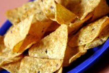 Whole-grain tortilla chips can be high in fiber, salt and fat.