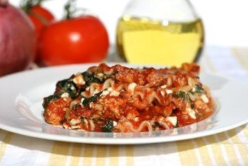 Enjoy healthier lasagna by adding veggies, like spinach.