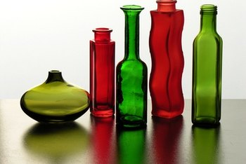 Reuse glass jars and bottles to hold cosmetics and office supplies.