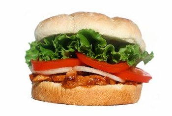 Lettuce and tomato add nutrition to a pulled pork sandwich.