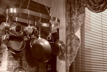 A pot rack is a country kitchen staple.