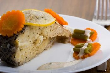 Cod, tuna, haddock and halibut are low-calorie, high-protein fish that are beneficial to your health.