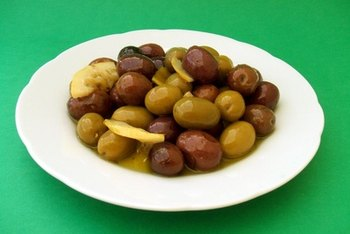Whole olives contain a variety of saturated and unsaturated fats.