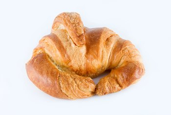 Croissants are higher in saturated fat than whole-grain bagels.