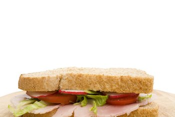 A ham sandwich on whole-wheat bread is a convenient but high-sodium choice for lunch.