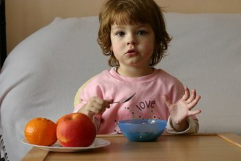 Fruit, whole-wheat cereals and nuts add healthy fiber to a child's breakfast.