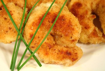 Breaded shrimp have more carbs than plain broiled shrimp.
