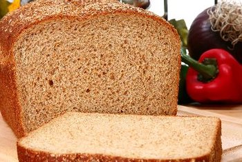 Whole-grain bread has a lower GI than refined white bread.