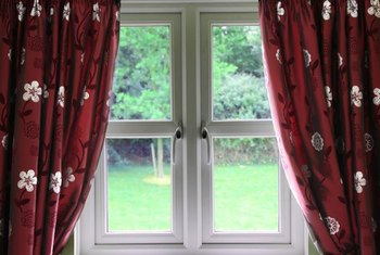 Adjust draw drapes so they close in the center of the window.