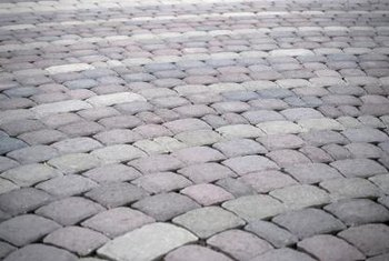 Install block-style paver stones to form a durable patio.