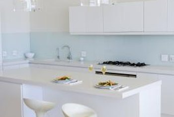 Pristine white laminate countertops offer economical durability with a modern twist.
