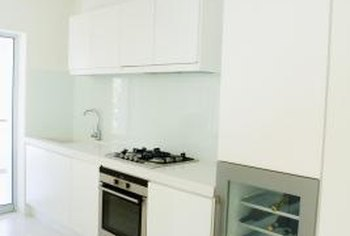 White sinks integral to the countertop help modernize the sink.