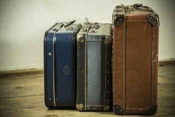 Stack vintage suitcases to create a table base with storage space inside.