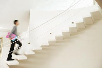 Floating staircases are simple and open, often eliminating risers and stringers.