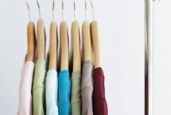 Rolling storage units allow quick access to your hanging clothes.