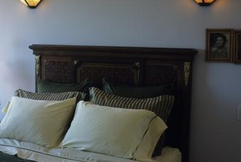 Antique and distress a headboard so that it matches your current decor.