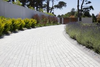 A running bond pattern is not the best choice for pavers in a sloped driveway.