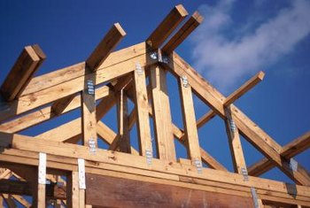 Manufactured roof trusses consist of rafters, ties and bridging.