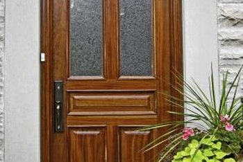Pebbled glass inserts are a decorative solution to a door that reveals too much.