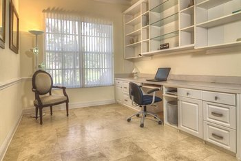 Travertine is a porous stone with a warm, textured appearance in this home office.