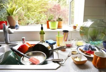 To keep your kitchen clean and germ-free, avoid the pileup of dirty dishes and clean right after cooking.