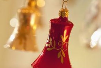 Hang Christmas ornaments from the chandelier for a blast of holiday cheer over the table.