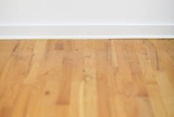 You must clean your wood floor thoroughly before painting your diamond square pattern.