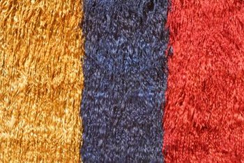 Rugs can disguise large sections of worn carpet.