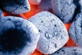 Limestone in commercial briquettes is what turns charcoal white as it burns.