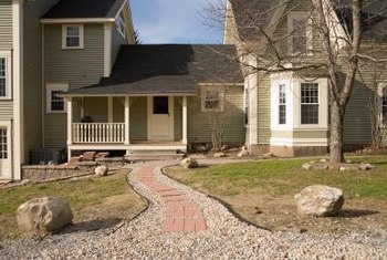 Several different types of rock are used to surround and accent a front porch.