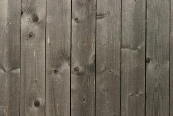 Power washing and staining can give an older fence a new look.