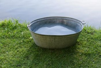 Transform a galvanized tub into a planter.