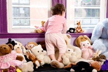 Babies and toddlers love to use cozy windowsill spaces in their creative play.