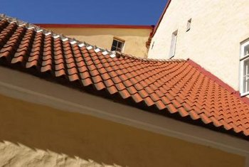 Terra-cotta tile roofs to help reflect the sun's rays.