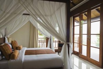 Canopy beds are often made of wood or metal.