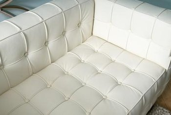 Decorate A Room With Contemporary Flair Using A White Leather Sofa And  Loveseat.