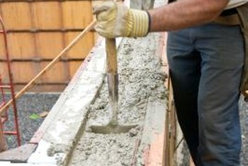 Concrete is composed of sand, small bits of gravel and Portland cement.